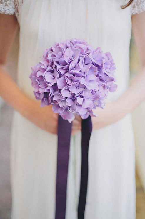 A simple bouquet of purple hydrangeas is simply stunning. #weddingbouquet
