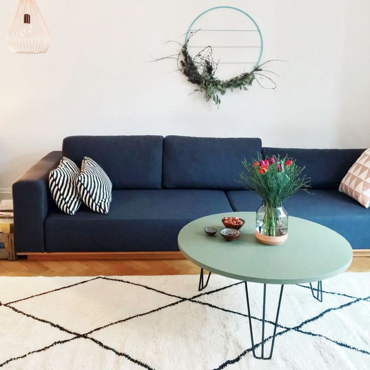 Rounded coffee table with olive linoleum surface at Johanna's living room. We love it!