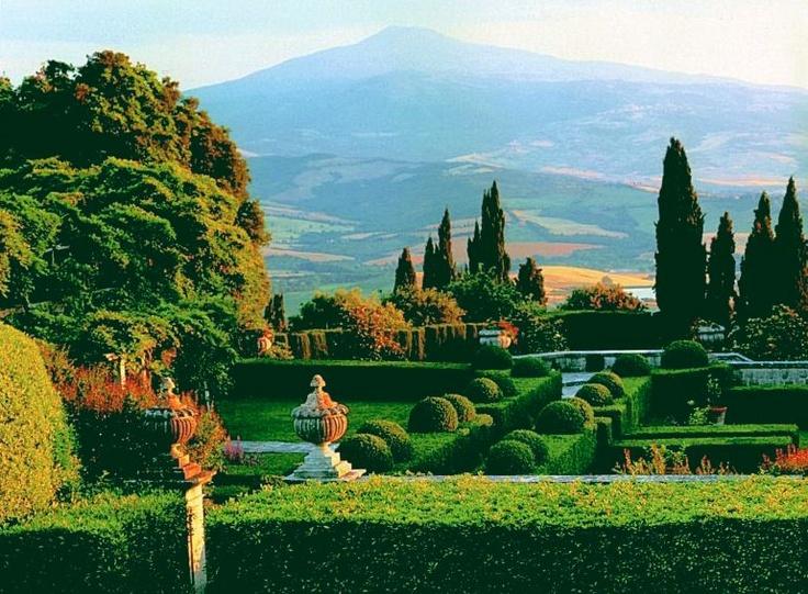 The garden of Villa La Foce, created by Cecil Pinsent for Iris Origo and her husband in the Crete Senese of Tuscany. That's Monte Amiata in the background. http://www.montepulciano.net/la_foce_iris_origo.htm