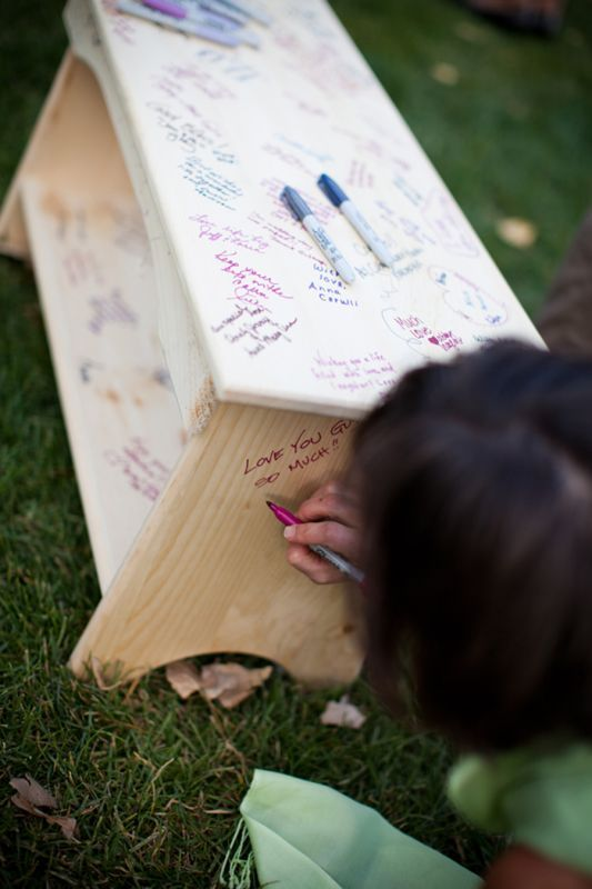 "Guest ""book"" bench! Have guests use sharpies on the unfinished wood, then seal it with clear coat a few days after:"