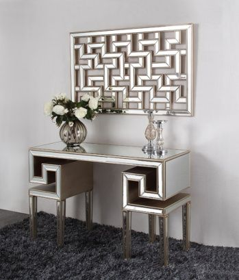 Mirrored console with gold trim.