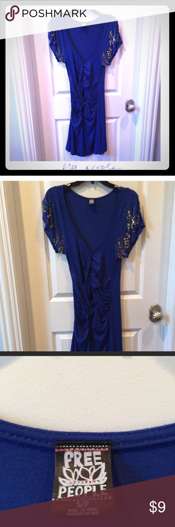 Free People royal blue sequin dress size S Free People size Small, slip-on style royal blue dress with embellished short sleeves and ruffle pattern across waist. Dress is gently worn; Sleeves missing some sequins (unnoticeable); free of piling, stains, holes, etc... Free People Dresses