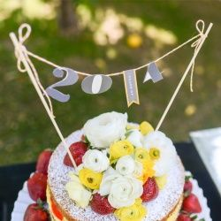 """The cake bunting on this easy, beautiful """"naked"""" cake was a snap to make, simply by cutting the 2014 out of an extra invitation. You don't g..."""