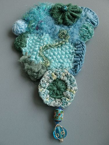Freeform crochet in shades of blue and green. Love the colors!