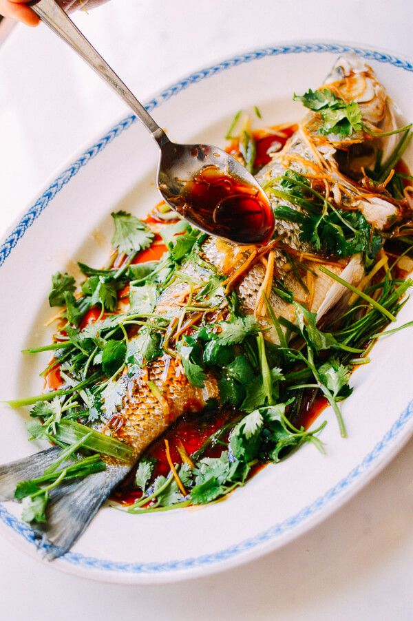 A steamed whole fish is a favorite on any Chinese table. This Cantonese steamed fish recipe with soy, scallion and ginger, and a tutorial on how to serve it at the table