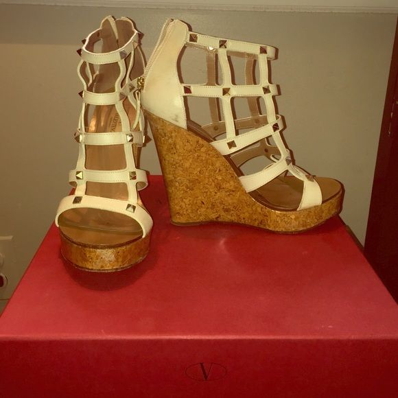 Authentic Valentino wedges Studded white Valentino wedges, one little scuff mark but that can b easily removed, other than that they are so beautiful and never go out of style. Valentino Shoes
