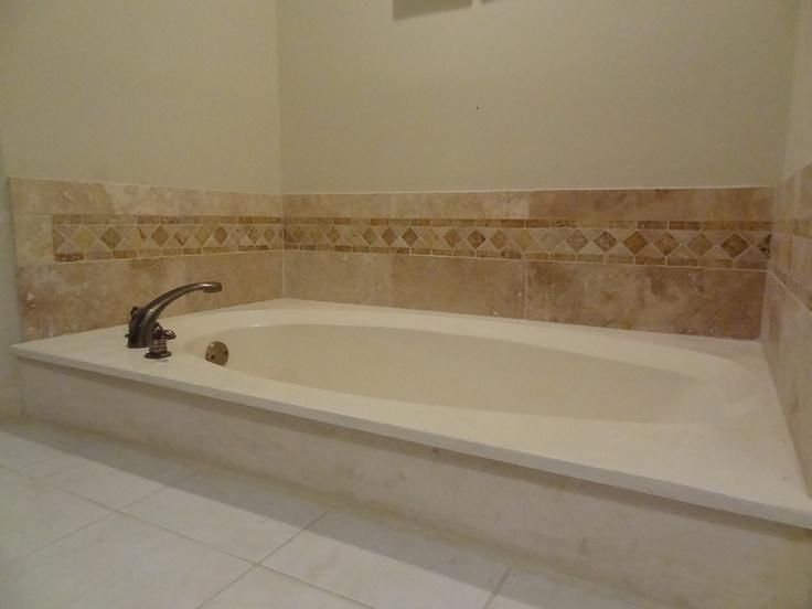 Our own finished bathtub backsplash of travertine tile