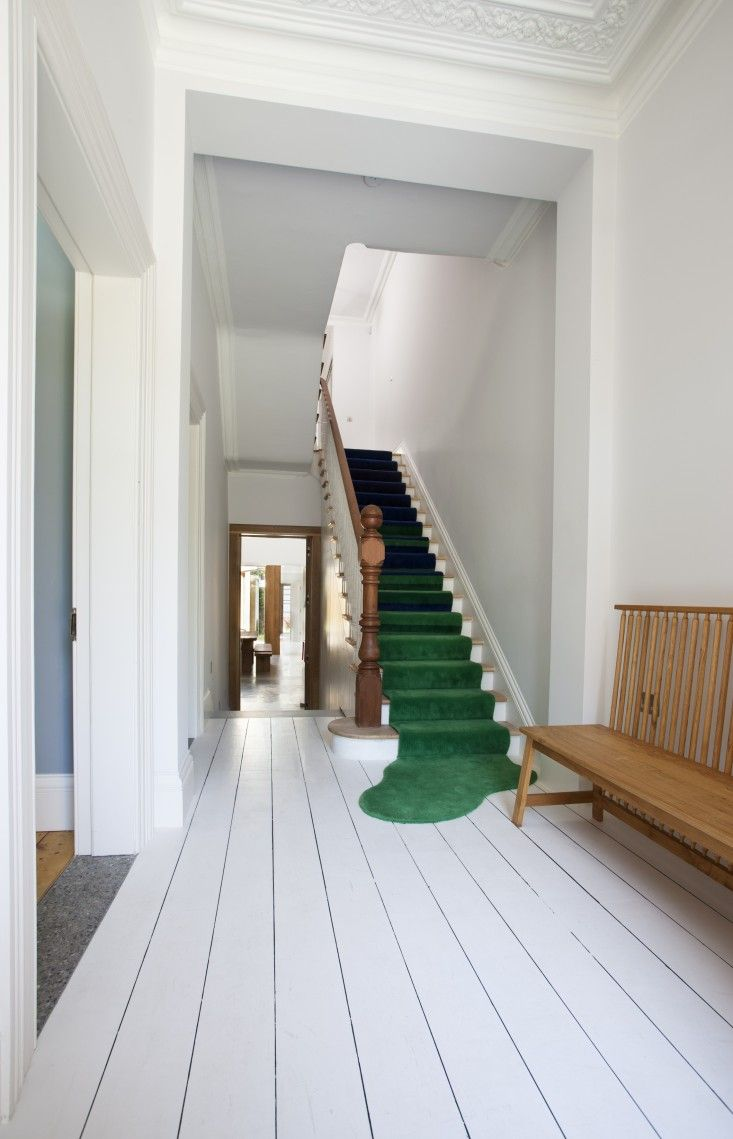 Green carpet runner on stair, Isle Crawford 446 Settee, Ballsbridge House, Dublin, Ireland by Peter Legge Architects | Remodelista