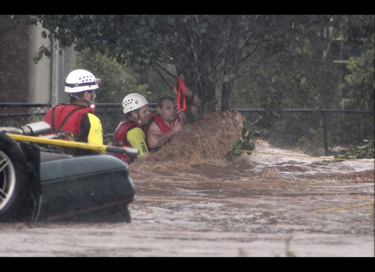 A man is rescued by emergency workers after he was stranded clinging to a tree on a flooded street in Toowoomba, Australia, during a flash flood Monday, Jan. 10, 2011. Flash floods swept through the northeastern Australian community killing one woman, trapping others in cars and leaving some clinging to trees as relentless rains brought more misery to a region battling its worst flooding in decades. (ABC / AP)
