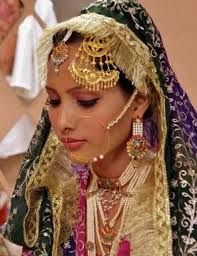 """humar or Jhoomar or Jhoomer: a bridal ornament that is worn in the hair, usually on the left side. Jhoomer has a clip that attaches it to the bride's hair.It is made of gold, silver, pearls, precious stones, crystals and is usually worn by North Indian brides and is popular among Muslim and Pakistani brides. Tamil Brides wear two round jewels on their hair; one in the shape of a sun (""""Surya Pirai"""") and the other in the shape of the moon (""""Chandra Pirai""""). Jhoomar in called """"Passa"""" in…"""