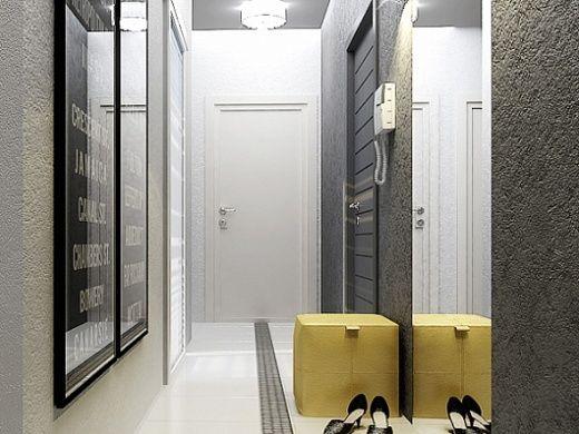 Прихожая узкая, вытянутая. Стены облицованы металлической мозаикой из алюминия и однотонной плиткой с текстурой «Серый беж». Из мебели здесь лишь пуф.