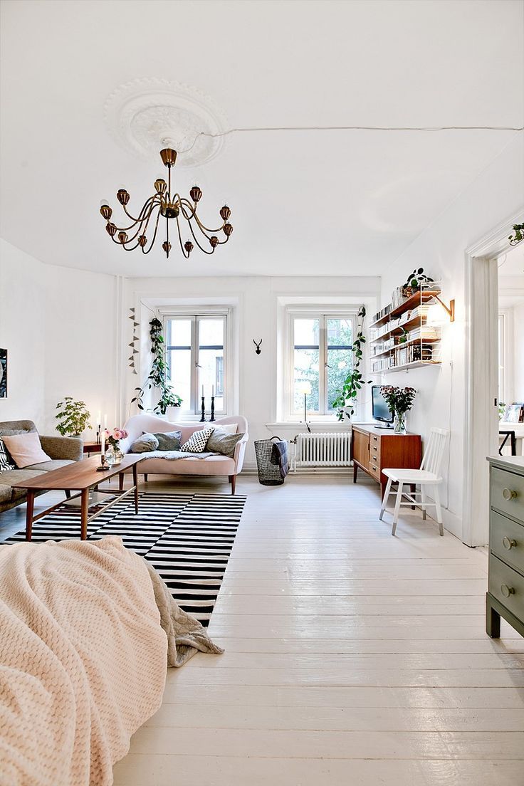 Scandinavian Style Studio Living White Walls Floors Black And Area Rug Chandelier Bright Open Space