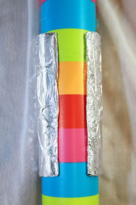 Cover a slit toilet paper roll with tinfoil to create an easy wrapping paper holder