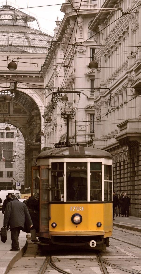 Street Tram in Milan, Italy - love the contrast between the yellow tram and the buildings
