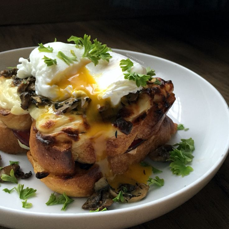 Croque-madame, topped with garlic & herb mushrooms.