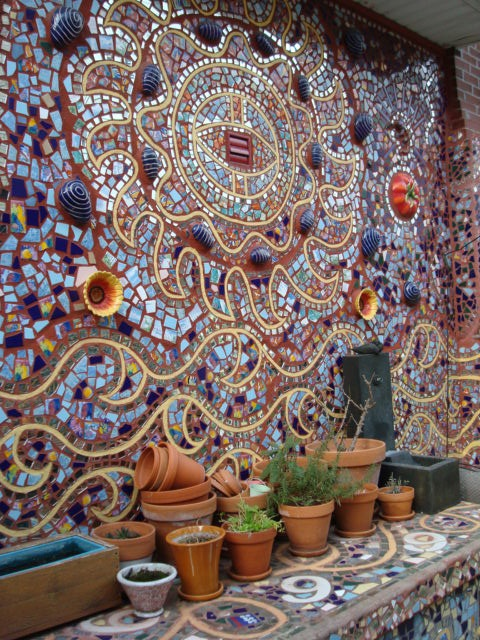 A patio covered in mosaics done by an apprentice of Isaiah Zagar's http://en.wikipedia.org/wiki/Isaiah_Zagar