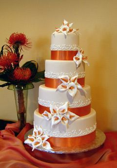 With wedding color of choice & a switch to a tropical flower like Hibiscus & you got a deal!  Cakes By Creme de la Creme - Washington