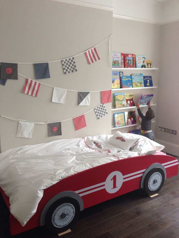 Racing car themed room. Vintage racing car bed from Maison du Monde, Bedding and bunting from the White Company, Ribba shelves from Ikea