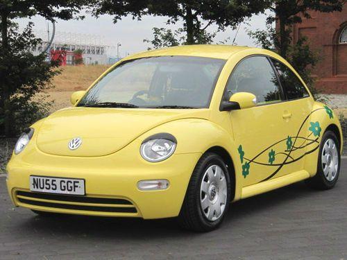 vw volkswagen  beetle yellow eyelashes  flowers  lady owner  www