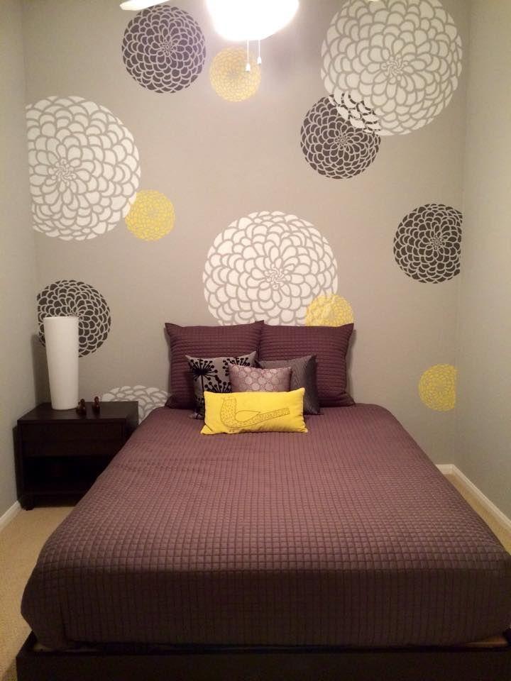 A DIY stenciled bedroom accent wall using the Zinnia Grande Stencil from Cutting Edge Stencils. http://www.cuttingedgestencils.com/flower-stencil-zinnia-wall.html
