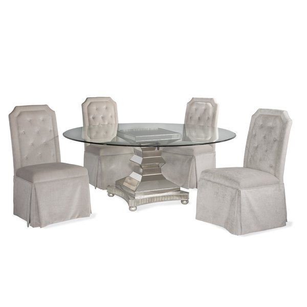 """The House of Hampton Crowthorne Dining Collection creates a prismatic effect using antiqued mirrored tiles, antique silver leaf beading and silver leaf bun feet. The accompanying chairs seen here feature thick PET """"velvet"""" clipped corner and button-tufted backs, and full skirting. The chairs are constructed using solid hardwood legs and framing. Casual and inviting yet always """"buttoned down"""", bring the luxury of Vintage Glam into your lifestyle environment."""