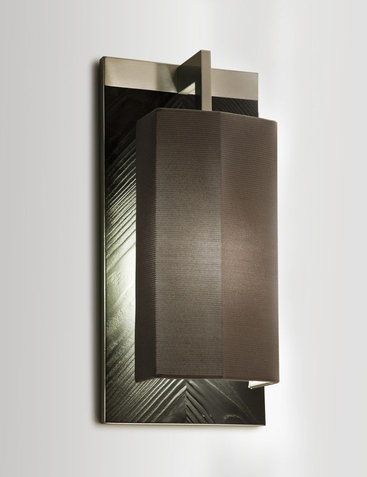 Masculine wall light by Tristan Auer. We'd love to see how this light reflects at night.