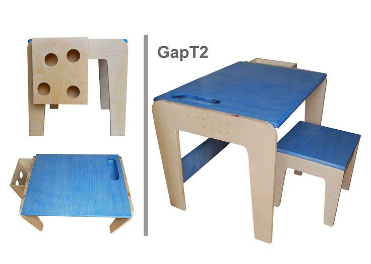 Stolik dla dzieci GapT2 Uprostrzona wersja stolika T1. W blacie głównym mamy otwór na kredeki. Z prawej strony blatu znajdują się otworki na przywiązane sznurkiem kredki. Z lewej strony stolika jest pudełko na papier rysunkowy, kartony, malunki. Więcej inforamcji na www.lapgap.pl