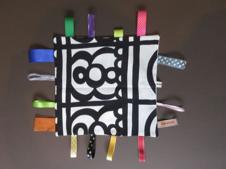 Gorgeous large cotton Taggie blanket with various multi coloured sensory ribbon…