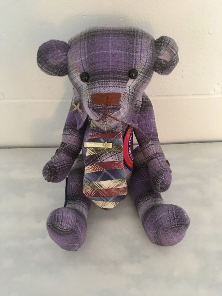 "One of four ""union brothers"" bears; four flannel shirts, deconstructed and used for custom ties"