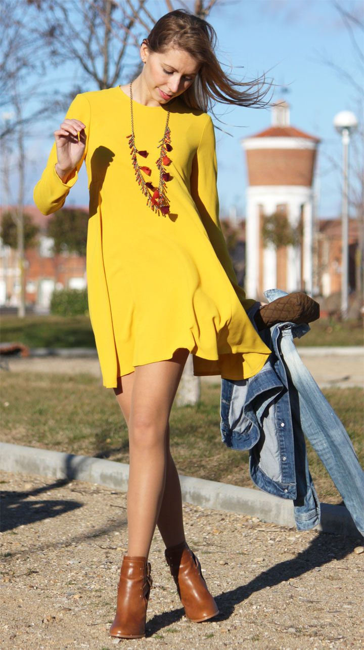 Yellow is my favorite color, and this dress is awesome. I like the covered up top with a shorter hemline that swings, and those booties are adorable.