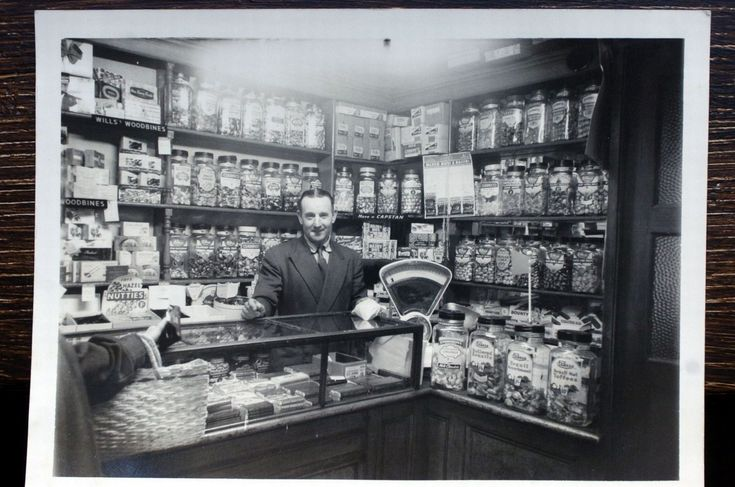 Arthur Bingham in his sweet shop in the 1940s at the back to back houses in Inge Street, Birmingham