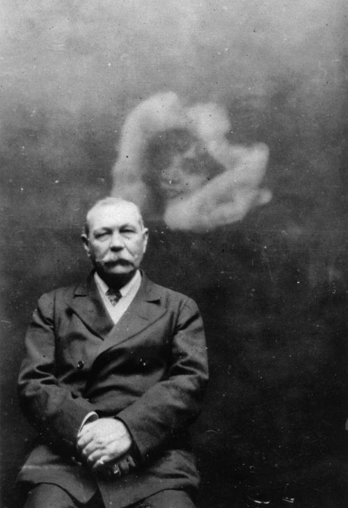 Sir Arthur Conan Doyle and a spirit, c. 1922  It is interesting that He created a character of unfailing logic, yet he believed in Spiritualism, seances
