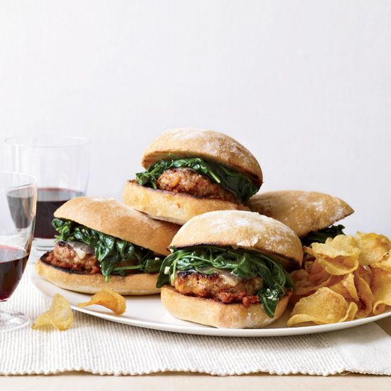 Italian-Sausage Burgers with Garlicky Spinach | Using sausage in burgers is a smart shortcut, because the meat is already seasoned.