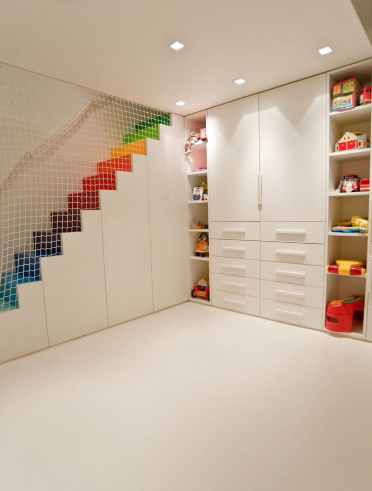 Rainbow Stairs Add Color To This Otherwise White Room