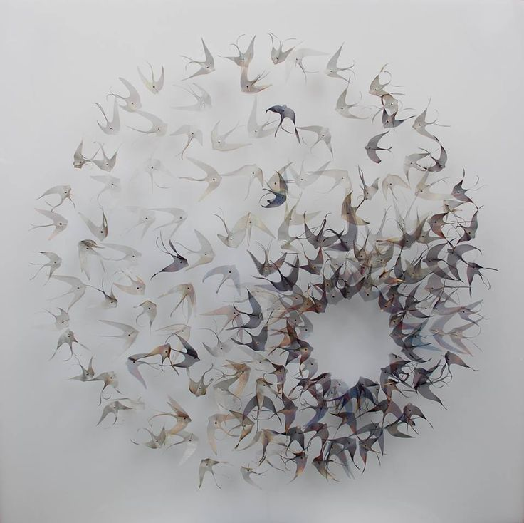 U.K. artist Michelle Mckinney examines the contrast of manmade materials with forms of nature in her ethereal installations of leaves, seeds, and butterflies formed from handcut woven metal. The artist cuts each shape from copper, brass, or steel mesh which is then colored and assembled into the forms seen here.