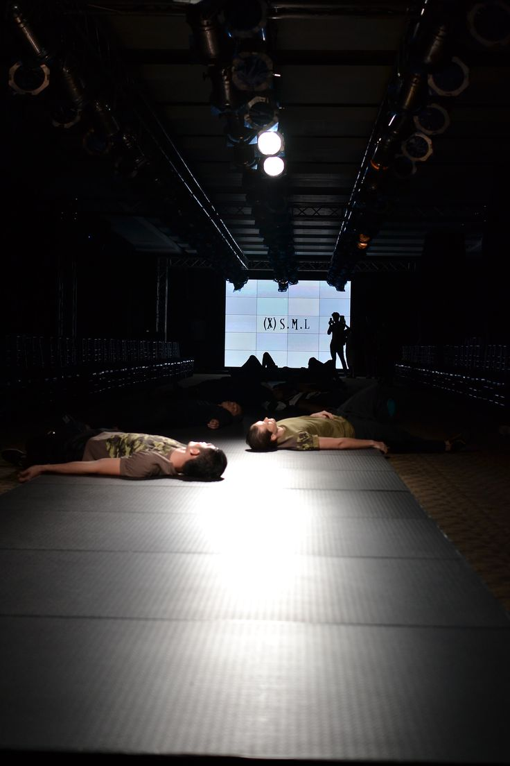They are sleeping? No! It is the opening choreography!