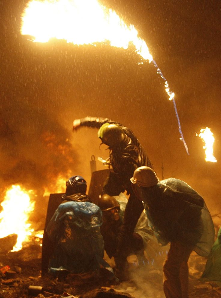 Protesters throw molotov cocktails at the riot police. Kiev