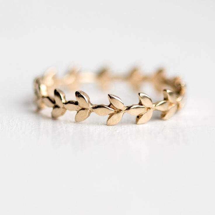 Vine Wedding Eternity Band in 14k yellow gold with bright polish finish.