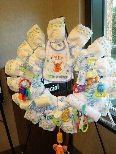 Diaper wreath homemade baby shower decoration, Ive done this several times...they look great on the hosp. door and during the shower.