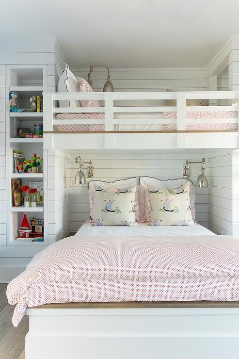 Coastal Living Showhouse - Fantastic girls' bedroom features a wall clad in shiplap painted Benjamin Moore Decorator's White lined with a full sized bed dressed in black and white scalloped shams, pink dot duvet and shams- Biscuit Home Katie Bedding - as well as pillows in Katie Ridder Beetlecat Fabric tucked under a loft bed illuminated by 1 Light Pimlico Double Swing Arm Sconces.