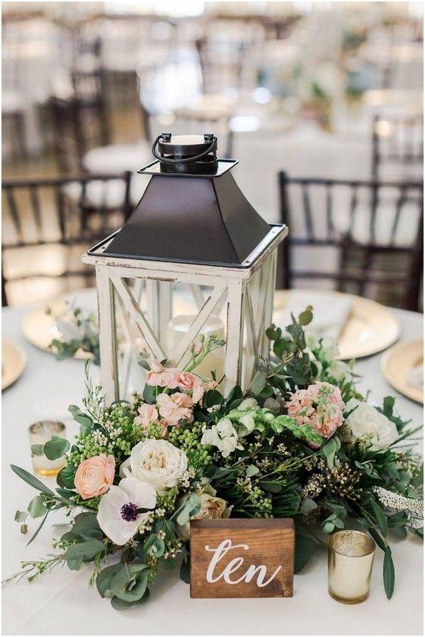 Lantern And Greens Centerpiece Lantern Centerpiece Wedding Romantic Wedding Centerpieces Wedding Table Centerpieces
