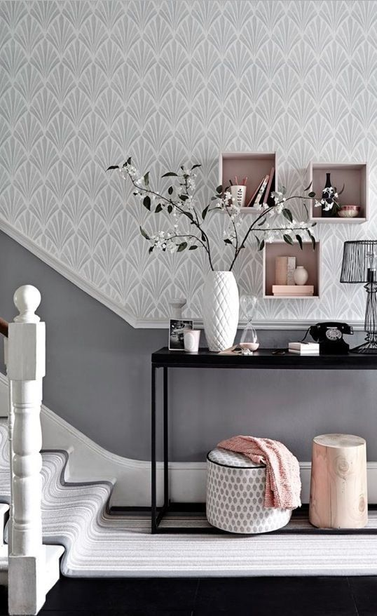 Team a patterned wallpaper in a soft shade with a darker toning paint colour for a hallway with impact. Box shelving is an easy and stylish storage solution.