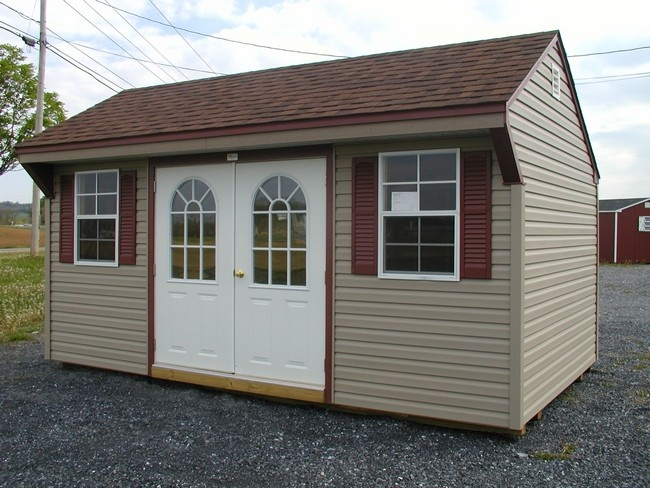 Clay siding brown roof and burgundy shutters with white for Tan siding shutter color combinations