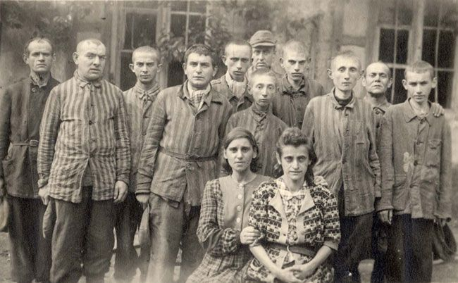 Jewish prisoners posing for a photograph after the liberation, Dachau, Germany, 1945 - Dachau was a concentration camp for opponents to the Nazi regime, including Jews. Approximately 67,000 prisoners were liberated there on 29 April, 1945, about a third of them Jews. Survivors of the camp had no possessions or means, and thus many of them walked free still wearing prison garb, as they had no other clothes to wear.
