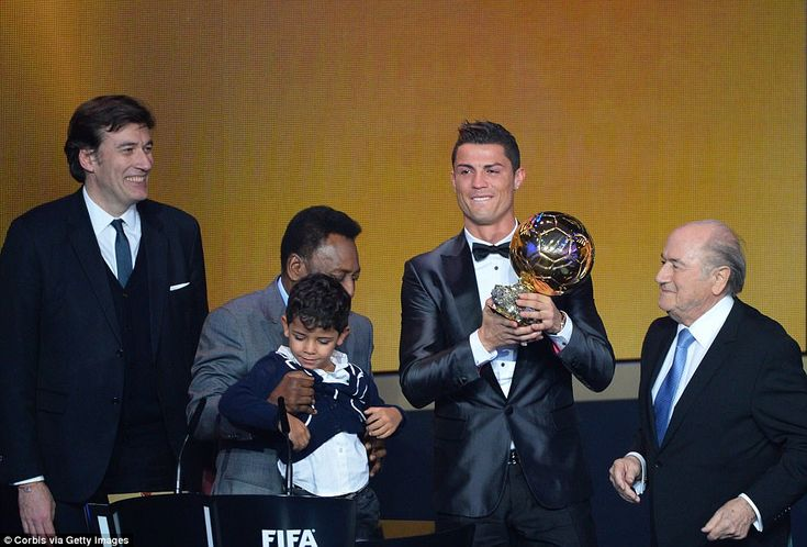 The Portuguese forward proudly displays his FIFA Ballon d'Or trophy in 2013 at a glitzy awards bash in Switzerland
