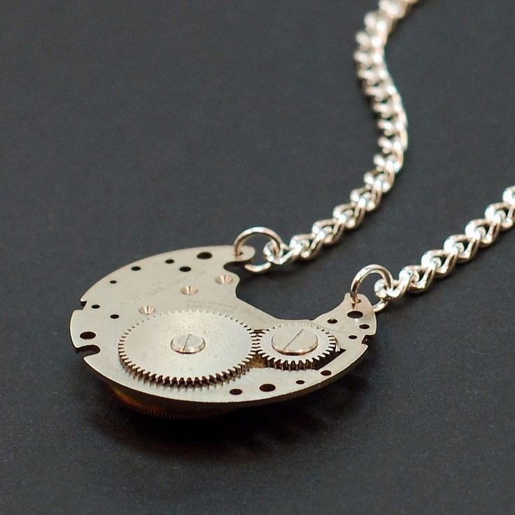 """Necklace from a vintage partial watch movement. On one side of the pendant are silver gears, on the other side brass and silver gears. The gears all still freely spin. The pendant measures about an inch in diameter. The chain and hook style clasp are silver plated. The necklace measures about 17 1/2"""" long.: Necklaces Measuring, Brass Reverse, Silver Gears, Silver Brass, Brass Revere, Revere Watches, Reverse Watches, Industrial Jewelry, Steampunk Necklaces"""