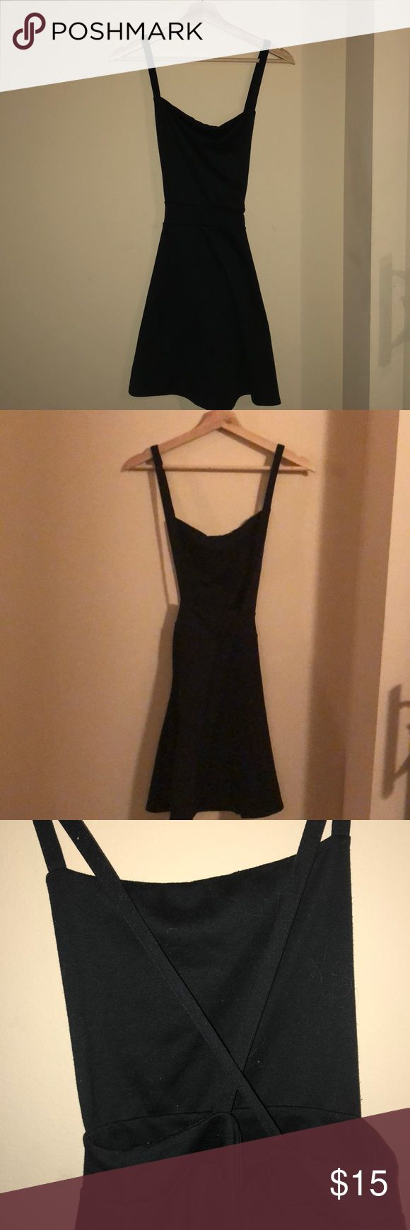 Black pinafore dress, US M (looks small in pics)🖤 What is it?: Black pinafore style dress, mini/thigh length, cross over at the back. Bought from Missguided, US M, stretchy fabric makes it flexible. Took tags off to try on but never worn.  Why selling?: I don't think the shape suits me Missguided Dresses Mini