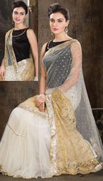 White color net multi-tyred style saree is with self woven design and embroidered motifs with 9-yard gotta patchwork borders.