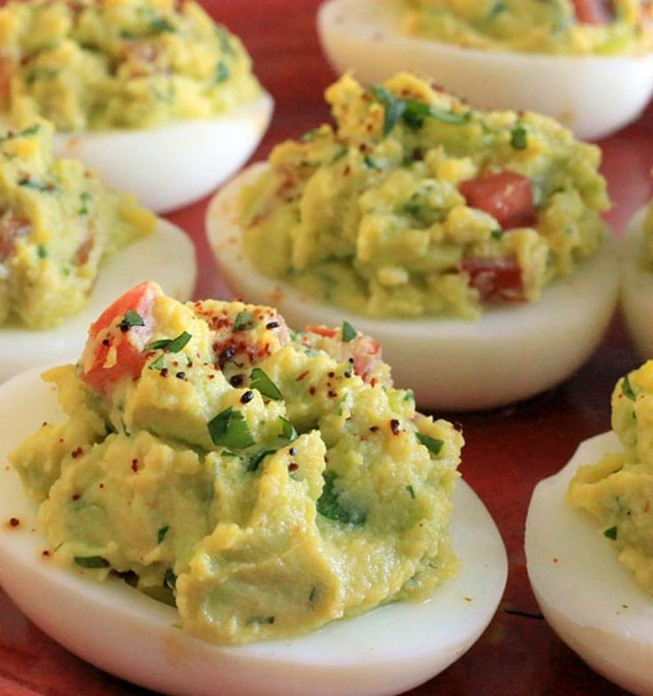 You'll be the talk of the potluck once you arrive with a tray of our guacamole deviled eggs. This is the kind of recipe where everyone hovers around the buffet table until all the 'little devils' are gone.