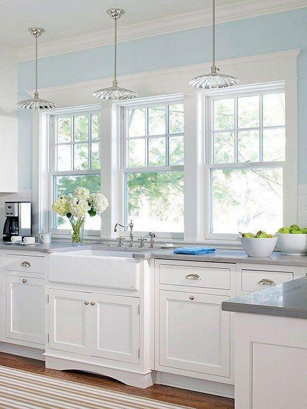 Bright white kitchen with the large windows. More via http://forcreativejuice.com/elegant-white-kitchen-interior-designs/